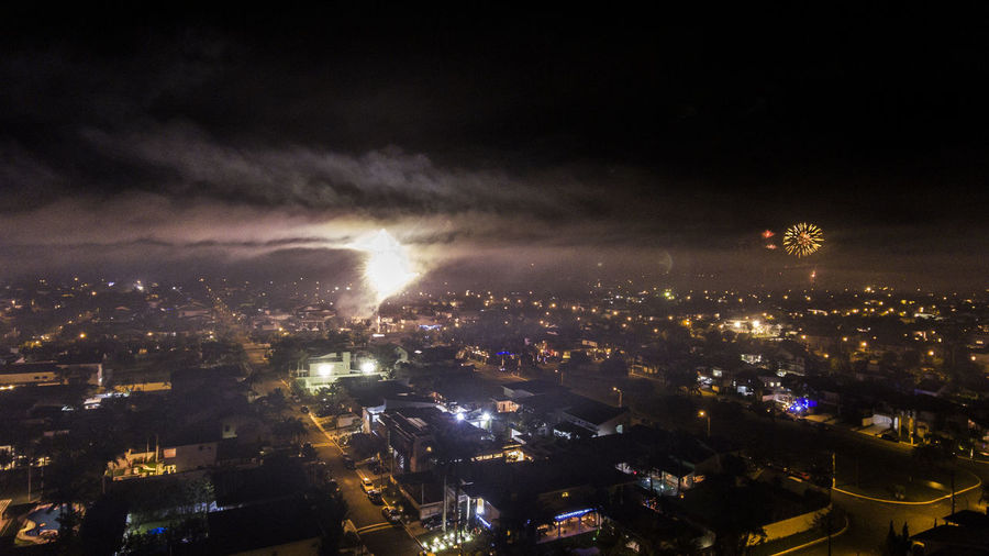 Architecture Building Exterior Built Structure City Cityscape Danger Firework Display Fireworks Forked Lightning Illuminated Lightning Night No People Outdoors Power In Nature Sky Storm Cloud Thunderstorm