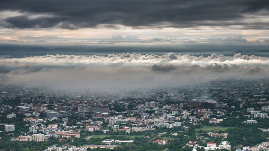 Aerial View Of Cityscape Against Cloudscape