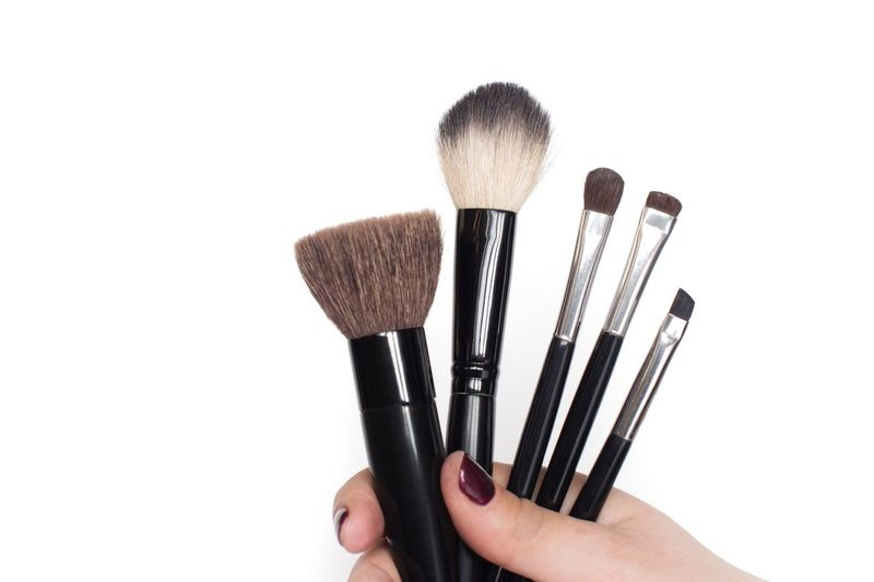 Makeup brushes in woman's hand on white background Copy Space Cosmetics Makeupartist Brushes Human Hand Make-up Brush Make-up Hand Human Body Part White Background Studio Shot Cut Out Beauty Product Fashion Beauty Holding