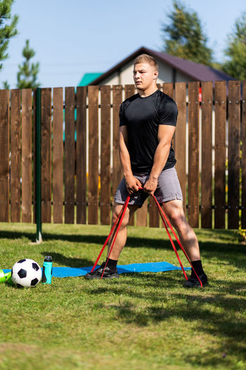 Man playing with ball on grass