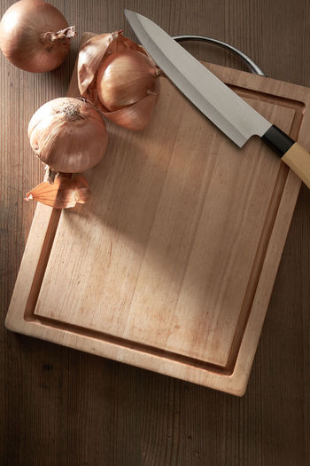 High angle view of chopped bread on cutting board