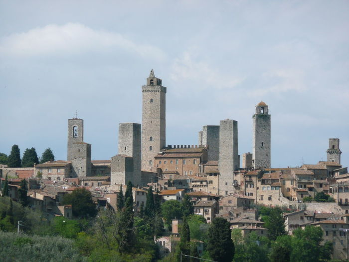 The towers of the Italian town of St Gimignano in Tuscany. Ancient Ancient Civilization Architecture Building Exterior Built Structure City Cityscape Day Gimignano History Italy No People Old Ruin Outdoors Sky St Gimignano Towers And Sky Travel Destinations Tree Tuscany