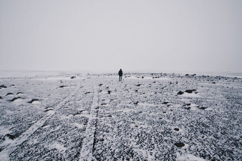 Distant view of people on beach during winter