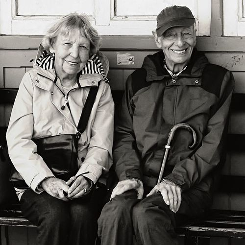 An elderly married couple shelter from the rain in a bus shelter. Two People Mature Adult Archival Senior Adult Togetherness Sitting Communication Love Adult Couple - Relationship Bonding Real People Eyeglasses  People Day First Eyeem Photo EyeEmBestPics Eyeemphotography EyeEm Best Shots EyeEm Gallery Blackandwhite Photography Portrait Smiling Happy EyeEmNewHere