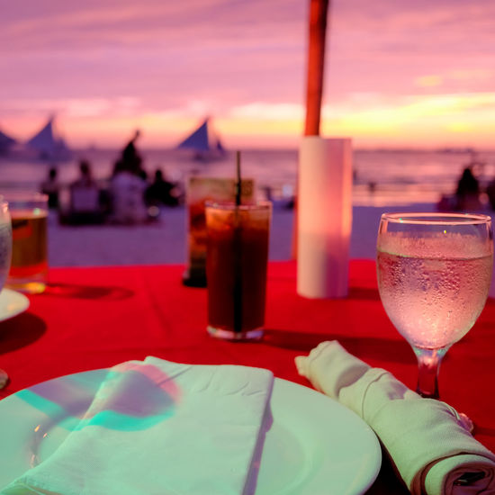 Philippines Travel Alcohol Bored Cloud - Sky Cocktail Drink Drinking Glass Focus On Foreground Food And Drink Freshness Glass Household Equipment Nature No People Outdoors Refreshment Restaurant Sea Setting Sky Sunset Table Water Wine