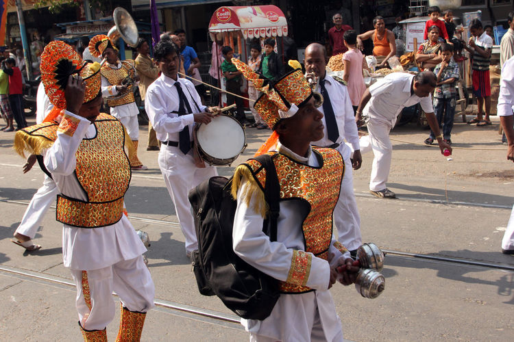 Marching band during procession at street