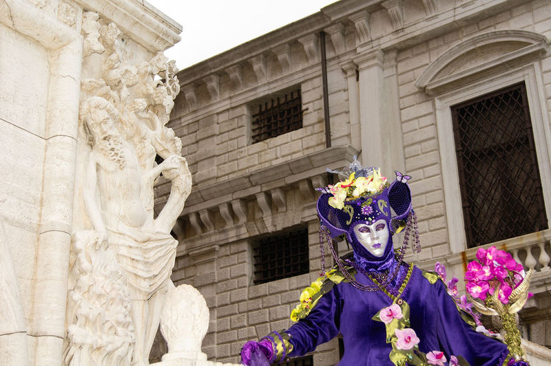 Carnival in Venice Carnival In Venice Venice, Italy Architecture Building Exterior Built Structure City Costume Day Flower Low Angle View Mask - Disguise Men One Person Outdoors People Real People Sculpture The Street Photographer - 2018 EyeEm Awards The Portraitist - 2018 EyeEm Awards