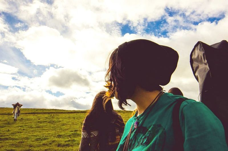 Close-up of woman looking away against sky