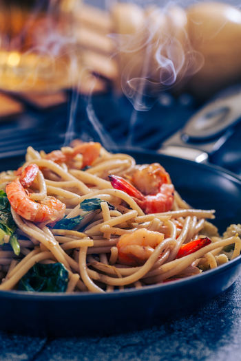 Food And Drink Food Italian Food Close-up Pasta Freshness Heat - Temperature Smoke - Physical Structure Kitchen Utensil Ready-to-eat Shrimp - Seafood Indoors  Seafood No People Focus On Foreground Healthy Eating Burning Meal Wellbeing Table Spaghetti Cooking Pan