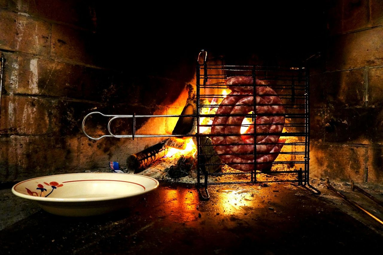 Meat on metal grate cooking in oven