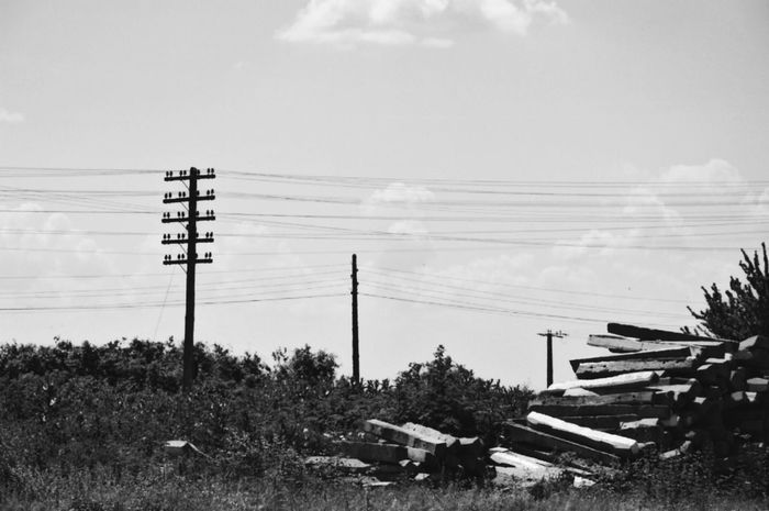 Near a train station. Cable Power Line  Sky Electricity Pylon Electricity  Cloud - Sky Connection Outdoors Tranquility Telephone Pole Telephone Line Landscape Nature Blackandwhite Nature_collection Romania Travel Travel Destinations Traveling Beauty In Nature Tranquil Scene Rsa_photo_of_the_day Scenics Built Structure Wood