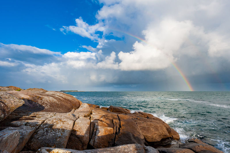 Rainbow at the coast of quiberon peninsula in brittany
