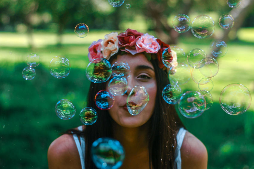 #bokeh #nature #bubbles #portrait #photography #girl #flower EyeEm Selects Bubble Bubble Wand Soap Sud Blowing One Woman Only Only Women Front View One Person Headshot Enjoyment People Lifestyles Motion Day