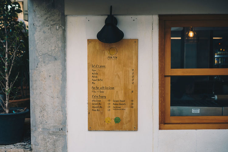 Communication Text No People Western Script Lighting Equipment Built Structure Script Sign Architecture Non-western Script Information Glass - Material Wood - Material Information Sign Hanging Indoors  Close-up Entrance Day Electric Lamp Message