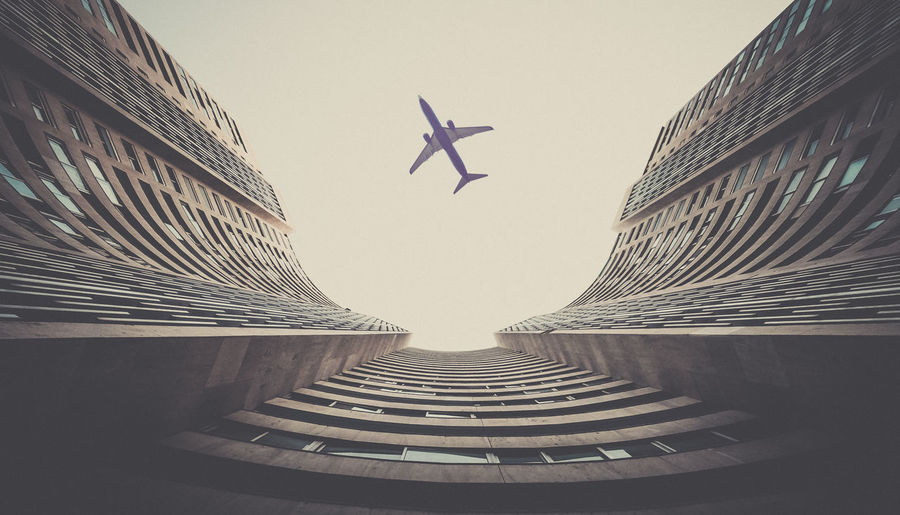 Plane above the building Aircraft Airplane Architecture Building Built Structure Clear Sky Close-up Day Flying Low Angle View Monaco No People Outdoors Sky
