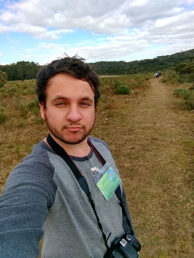 Casual Clothing Cloud - Sky Day Field Front View Grass Landscape Leisure Activity Lifestyles Looking At Camera Nature One Person Outdoors People Portrait Real People Selfie Sky Standing Young Adult