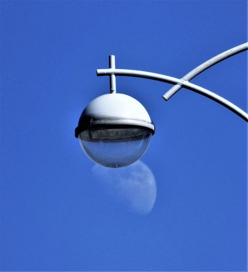 Blue Sky Clear Sky Low Angle View No People Copy Space Lighting Equipment Nature Sphere Day Outdoors Technology Connection Street Light Sunlight Street Electrical Equipment Moon Day Moon