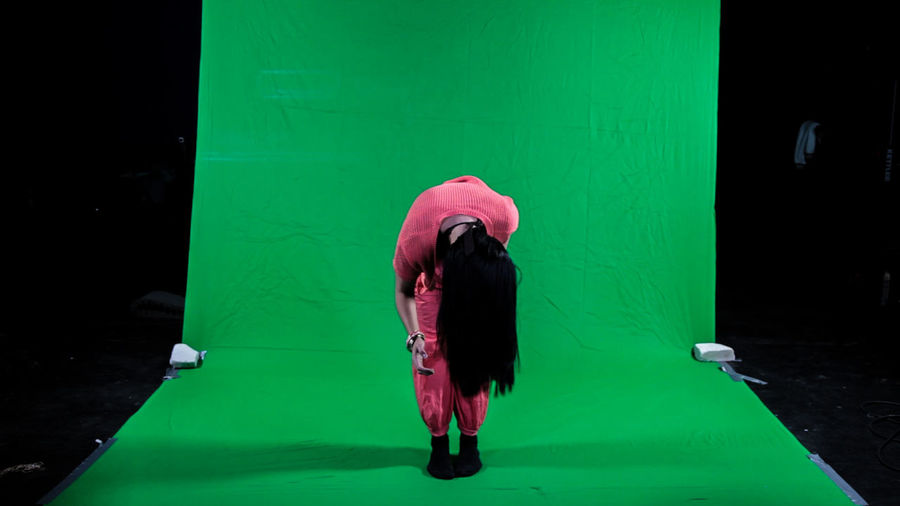 Full Length Of Woman Bending In Studio