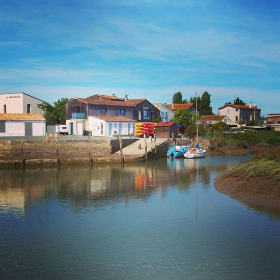 Water Reflection House Building Exterior Nautical Vessel Outdoors Sunny Day Sea Clear Sky Architecture Sky No People Blue Built Structure Beach Landscape Vacations Tree Mornacsurseudre Charentemaritime France Photos Francetourisme Charente-Maritime Nature