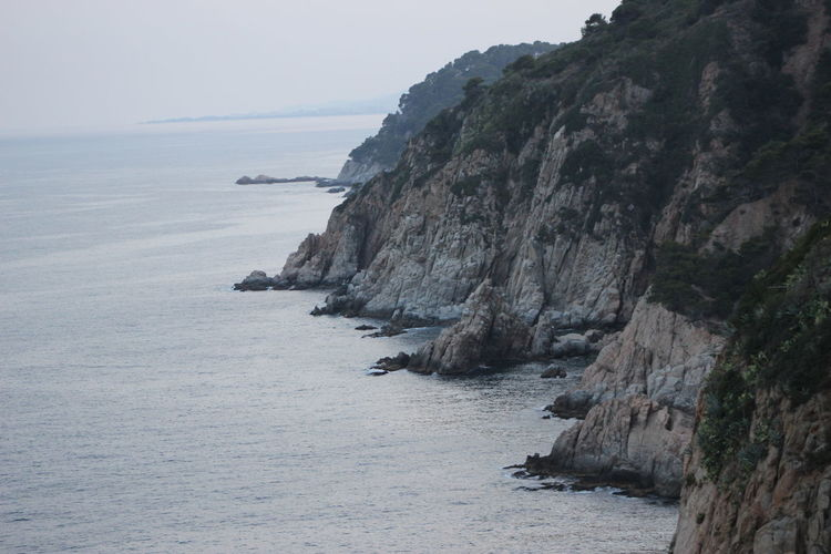 High angle view of rock formations by sea