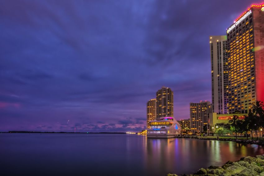 Miami Vibes Architecture City Building Exterior Waterfront Built Structure Sky Skyscraper Modern Reflection Cloud - Sky Tower No People Outdoors River Illuminated Urban Skyline Cityscape Night Nature