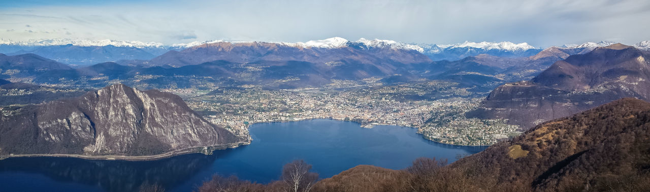 Wide angle view of lake lugano and the alps from the belvedere sighignola