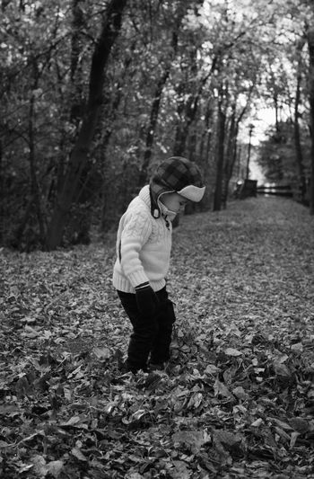 Kid Boy Hat Blackandwhite Beautiful EyeEm Selects Portraits Be Brave Light Shadows & Lights Sweaterweather Fall Autumn Tree Full Length Farmer Men Agriculture Working Field Standing Farm Worker Growing Change Fallen Leaf Autumn Collection Leaves Maple Leaf Fallen Warm Clothing