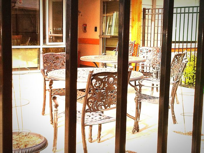 Urban Spring Fever Window Things I Like Cafe Americano Empty Places Empty Chair Empty Cafe Behind Bars Exterior View Patio No People Wrought Iron Iron