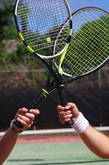 Close-up Competition Court Day Focus On Foreground Holding Human Body Part Human Hand Leisure Activity Lifestyles Men Outdoors People Playing Real People Sport Tennis Tennis Racket