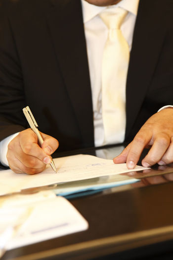 Adult Business Businessman Close-up Day Document Human Body Part Human Hand Men Office One Man Only One Person Only Men Pen People Signature Well-dressed Working Writing Young Adult