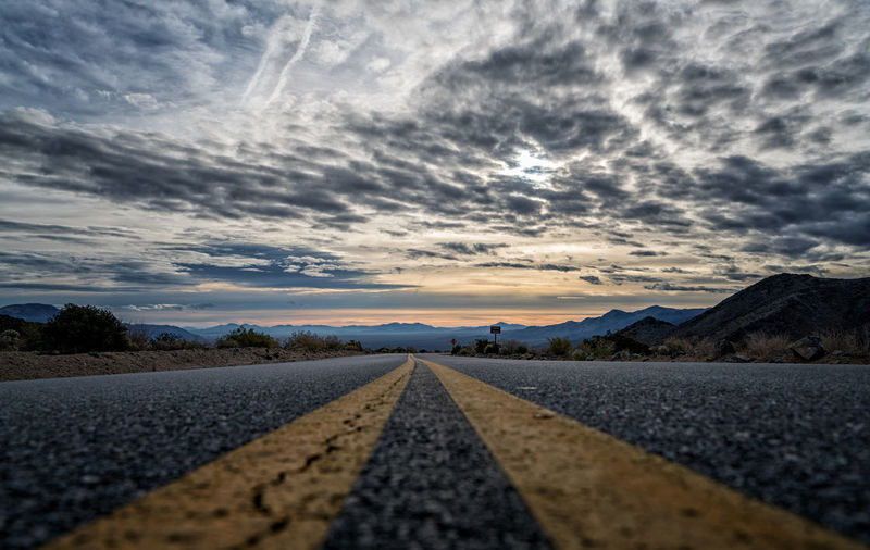 Road against dramatic sky