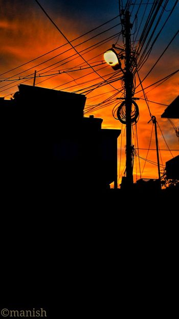 Power Line  Sunset Cable Sky Built Structure Architecture City Life Outdoors Power Supply Cloud - Sky Sun Residential Building Dark City Silhouette Outline Electricity Pylon Building Exterior Power Cable Low Angle View Substitute