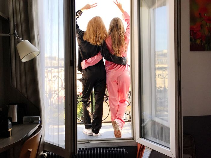 Two girls on balcony View Paris Pijamas Pijama Frendship Friends Friend Sisters Indoors  Two People Window Child Rear View Children Only Looking Through Window Blond Hair Day Girls Lifestyles Real People Home Interior People Togetherness