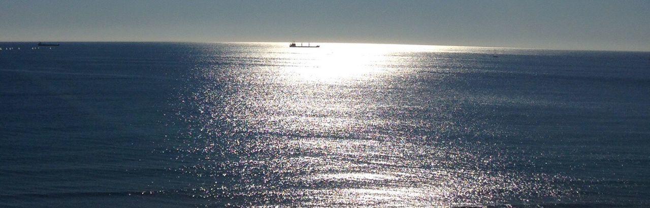 sea, water, horizon over water, scenics, tranquil scene, tranquility, nature, sunlight, rippled, beauty in nature, waterfront, no people, reflection, outdoors, day, nautical vessel, beach, sailing, sky
