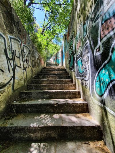 Low angle view of steps and graffiti on wall