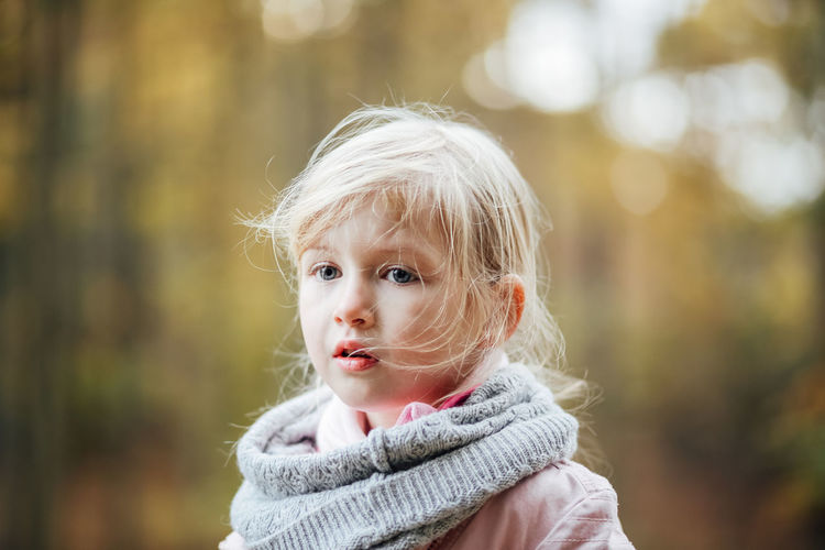 Portrait Headshot Childhood Blond Hair Child Focus On Foreground One Person Hair Looking At Camera Close-up Day Innocence Warm Clothing Looking Cute Scarf Outdoors Contemplation Hairstyle