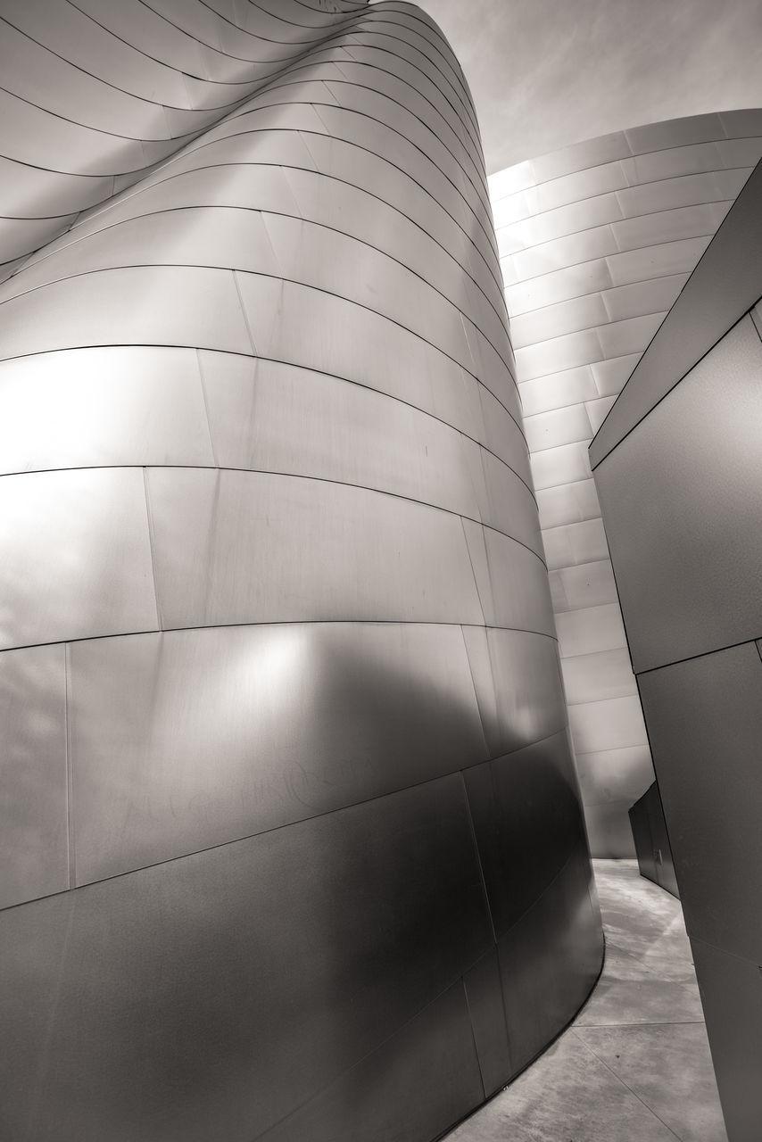 MODERN BUILDING AGAINST SKY SEEN THROUGH WALL