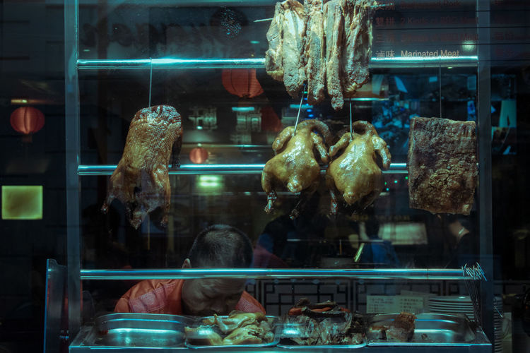 Glass - Material Retail  Store Window Night Transparent Reflection Retail Display Illuminated Store Window Hanging No People For Sale Animal Business Animal Themes Lighting Equipment Animals In Captivity Indoors  Architecture