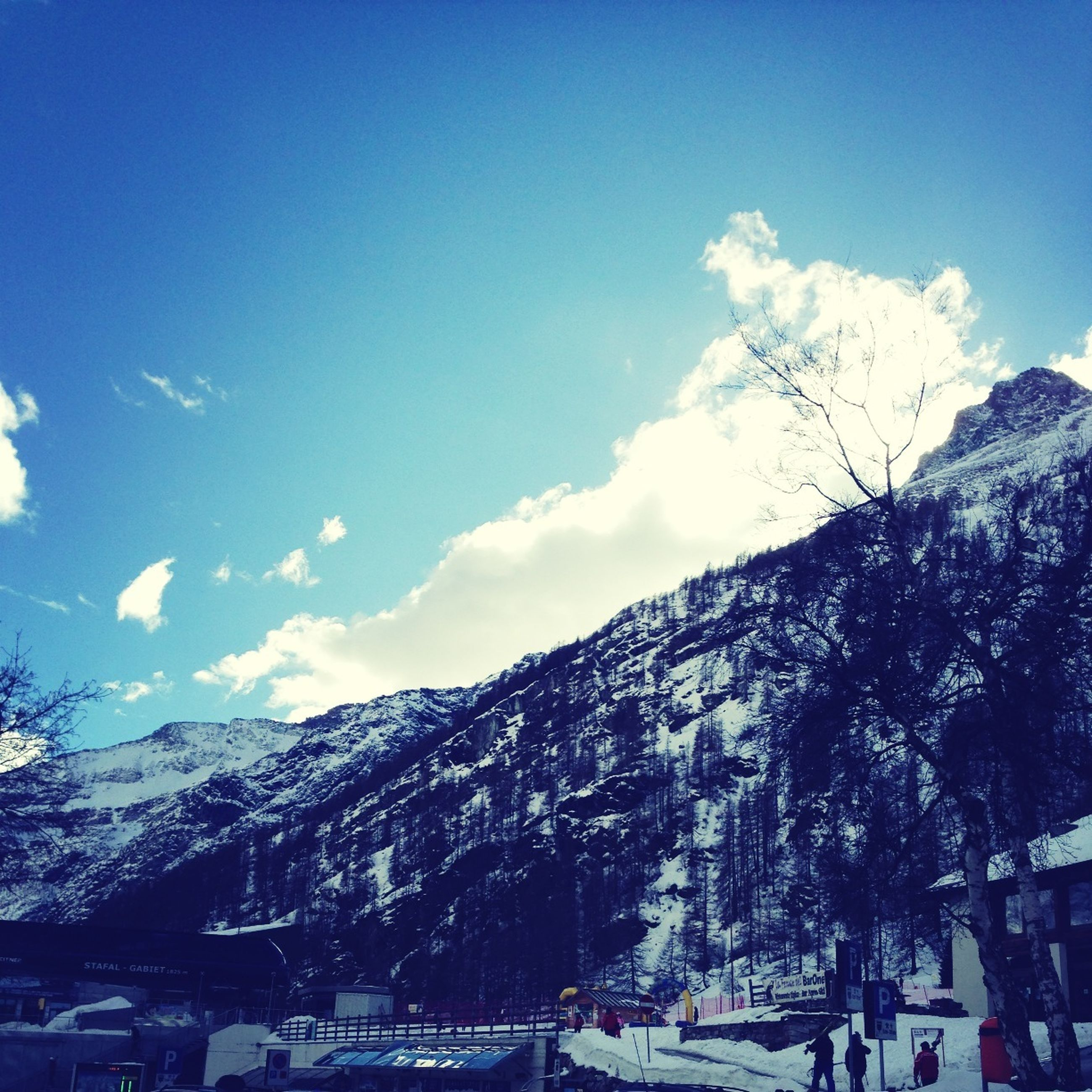 snow, mountain, winter, cold temperature, sky, building exterior, blue, tree, built structure, season, snowcapped mountain, mountain range, architecture, house, scenics, beauty in nature, nature, landscape, tranquil scene, tranquility