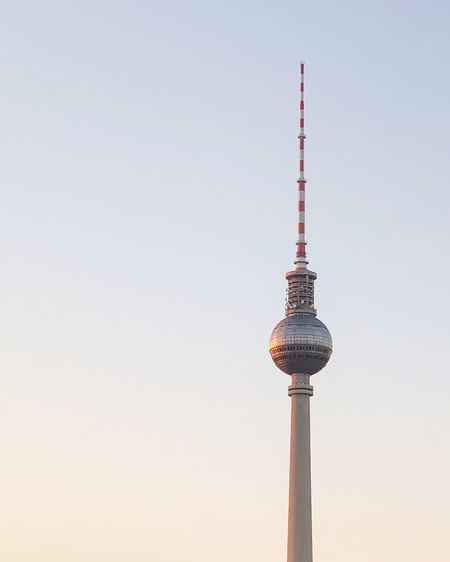 Communications tower against sky in city