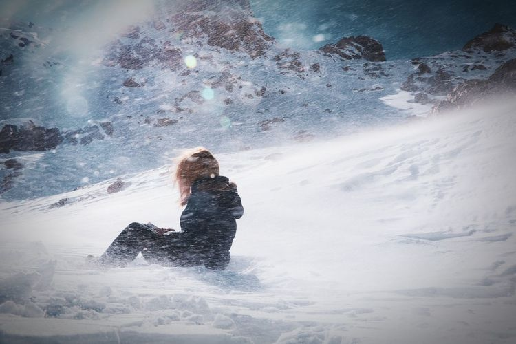 Woman standing on snow covered landscape during winter