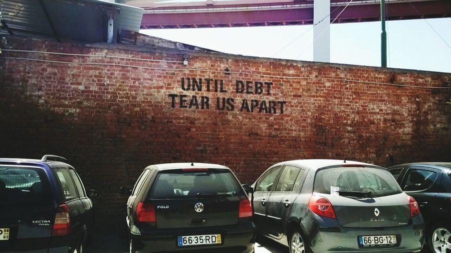 Debt Debt Crisis Car Loan City Car Text Architecture Built Structure Parking Parking Lot Mode Of Transport