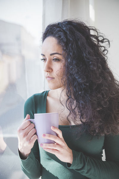 Adult Adults Only Close-up Coffee - Drink Coffee Cup Curly Hair Day Front View Holding Indoors  Leisure Activity One Person One Woman Only One Young Woman Only Only Women People Technology Women Young Adult Young Women