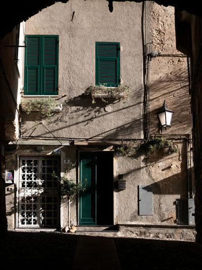 Cervo, Liguria, Italy Architecture Building Exterior Built Structure Window Building Door Entrance Residential District No People City House Outdoors Sunlight Façade Location Shadow Wall Cervo Cervo Ligure Liguria Italy Mediterranean  Caruggi Carugi Typical