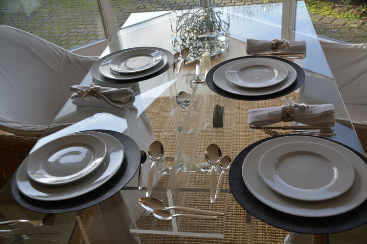 High angle view of crockery on dining table at home