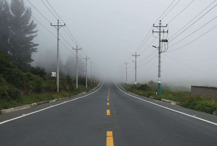 Connection Country Road Diminishing Perspective Electricity Pylon Empty Road Foggy Highway Landscape Lines Long No People Road Road Marking Sky Straight Street The Way Forward Traveling Unknown Vegetation