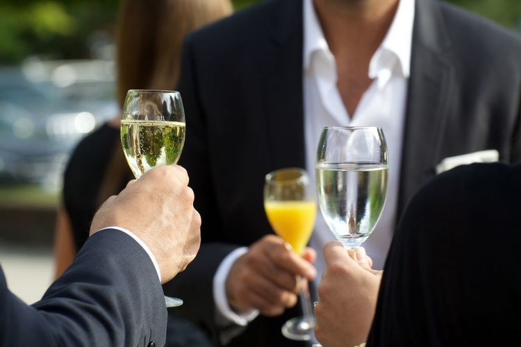 People Toasting With Glasses Of Champagne In Party
