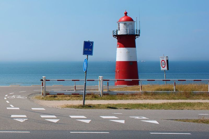 Lighthouse Lighthouse Guidance Safety Protection Security Direction Communication Striped Horizon Over Water Road Sea Day Clear Sky Blue Sky Netherlands Northsea Zeeland  Nikond750 Eye4photography  Colourful Dutch Landscape Seascape Red Sharkteeth Landscape