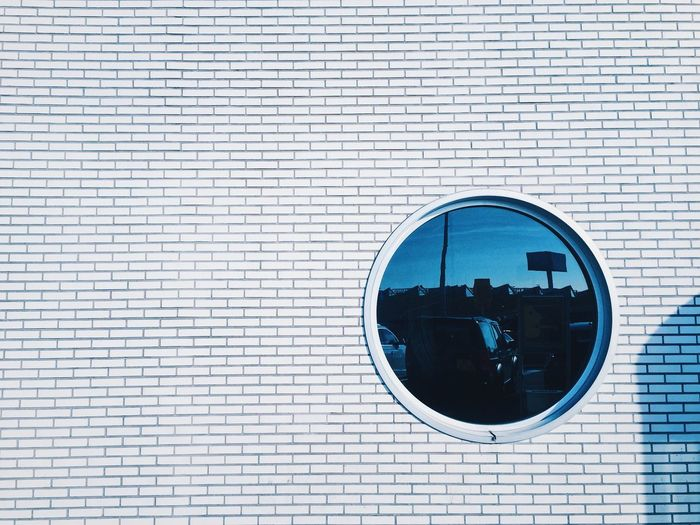 Those day in Amsterdam. EyeEmNewHere Photo EyeEm Best Shots EyeEmBestPics EyeEmNewHere VSCO Shape Geometric Shape Circle Architecture Building Exterior Built Structure Day Wall - Building Feature Brick Window Wall Reflection Outdoors Building No People Pattern Brick Wall