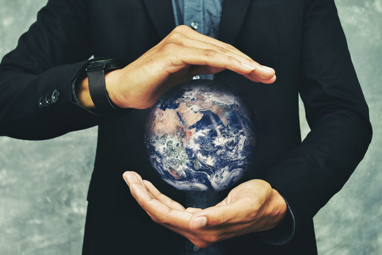 If the world is in your of power and rule ,Earth image provided by Nasa. Business Earth Power World Heritage Adult Business Finance And Industry Day Front View Hand Holding Human Body Part Human Hand Males  Men Midsection Nature One Person Outdoors Real People Responsibility Showing Sphere Standing Technology